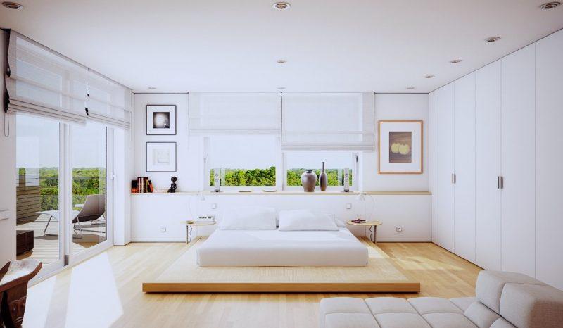 Фото інтер'єру великої світлої спальні