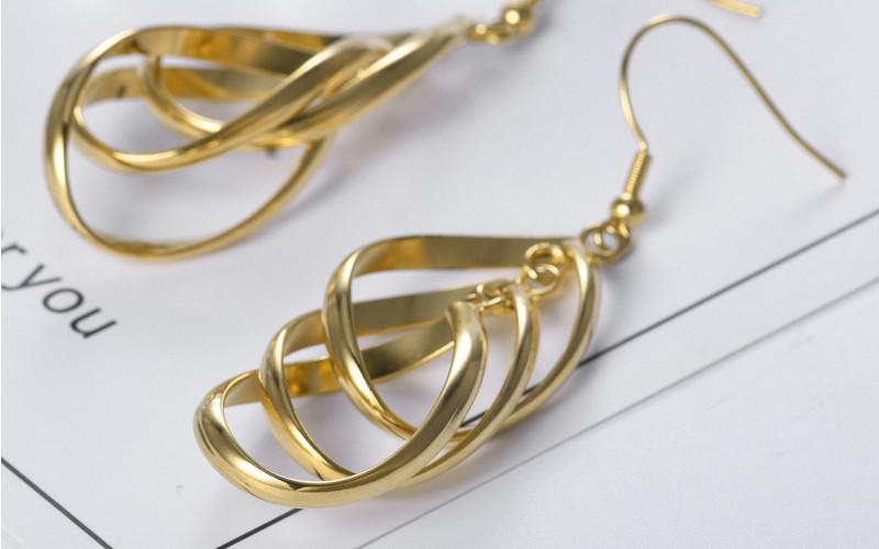 Модні золоті сережки фото - 15