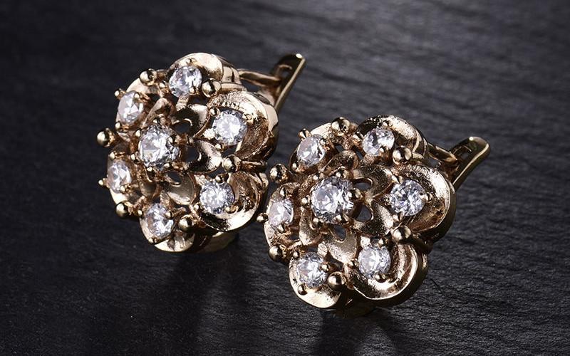 Модні золоті сережки фото - 17