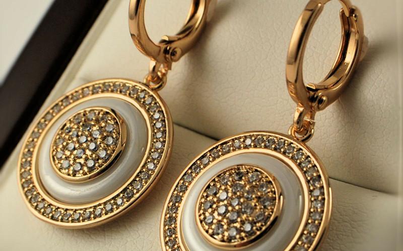Модні золоті сережки фото - 19