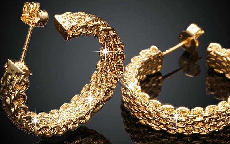 Модні золоті сережки фото - 24
