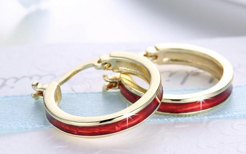Модні золоті сережки фото - 25