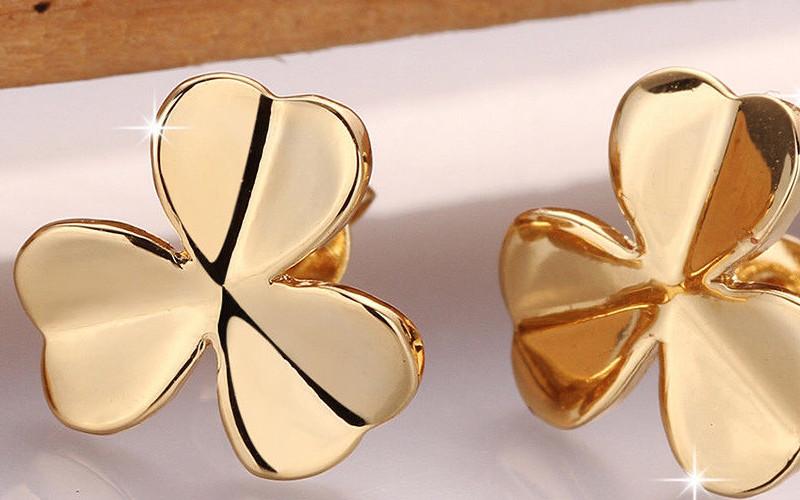 Модні золоті сережки фото - 26