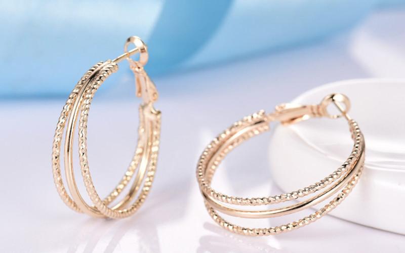 Модні золоті сережки фото - 5